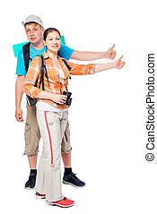 Couple hikers with backpacks hitchhiking, shooting on white background