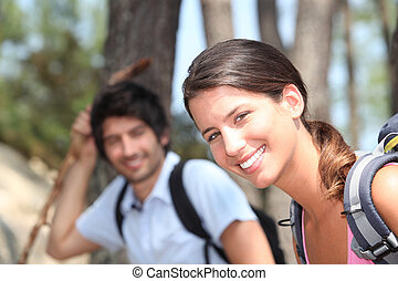 Couple hiking in the forest