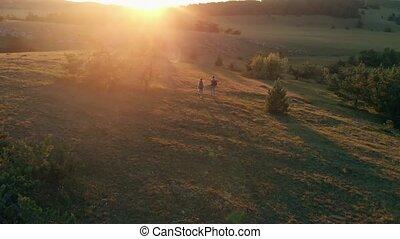 Couple hiking on sunset