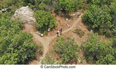 Couple hiking walking a pach - Man and woman traveling with...