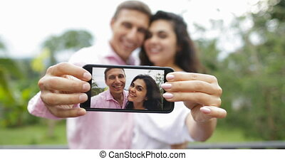 Couple Hold Cell Smart Phone Take Selfie Photo Embracing...