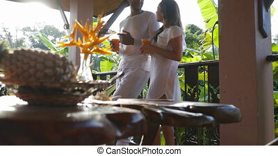 Couple Hold Juice Glass Talking Standing On Balcony, Man And...