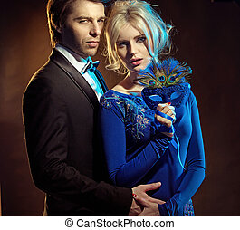 Couple holding a blue mask