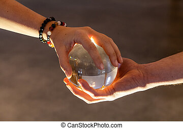 Couple holding a crystal ball together
