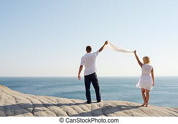 Couple holding a white handkerchief