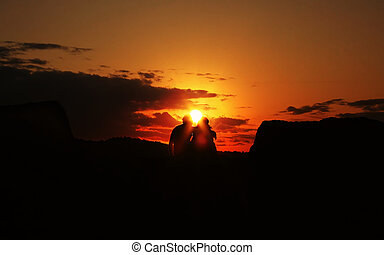 couple holding each other during a sunrise
