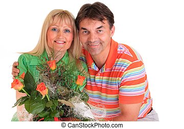 Couple holding flowers