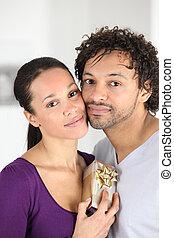 Couple holding gift