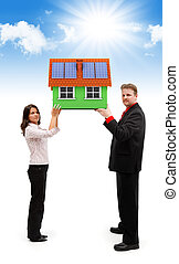 Couple holding green house