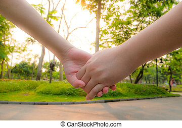 couple holding hand in sunset