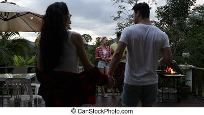 Couple Holding Hand Join People Having Barbecue Party On...
