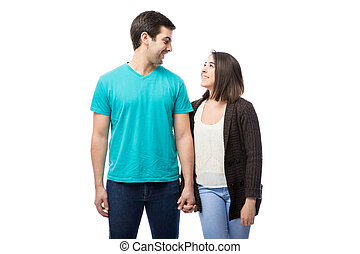 Couple holding hands and looking at each other