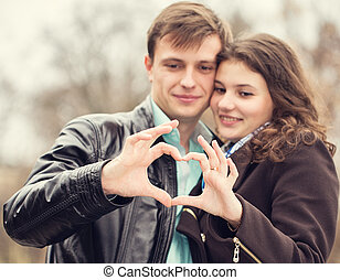 couple holding hands heart