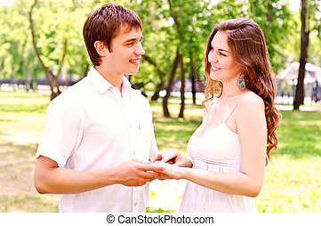 couple holding hands in the park