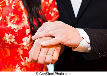 Couple holding hands in wedding day