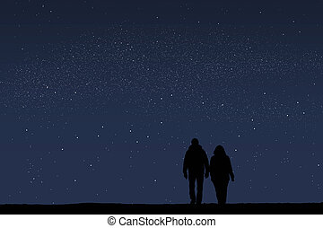 Couple holding hands on starry night