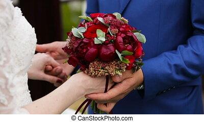 Couple holding hands on wedding ceremony