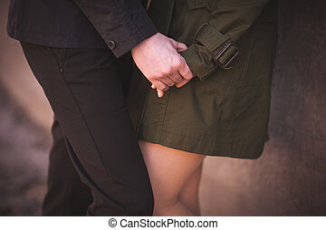 couple in love holding hands together no face