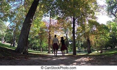 Couple Holding Hands Together Walk Away Buen Retiro Park...