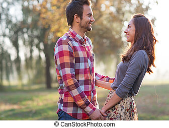 Couple Holding Hands Walking Away, smiling