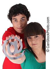 Couple holding metallic at symbol