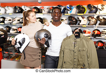 Couple holding purchased riding gear