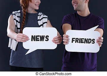 Couple holding speech bubbles