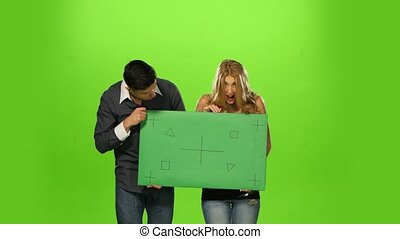 Couple holding up a blank sign, green screen