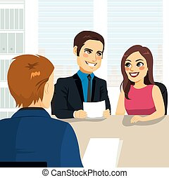 Couple Home Loan - Young couple at bank about to sign loan...