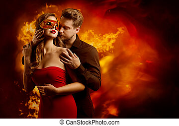 Couple Hot Flaming Kiss, Man in Love Kissing Seductive Dreaming Woman in Fantasy Red Mask