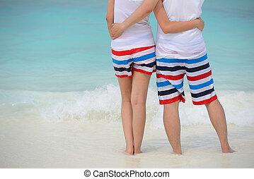 couple hug together on the beach