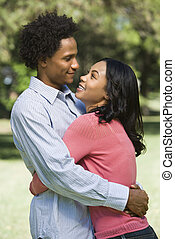 Couple hugging. - Attractive couple smiling and embracing in...