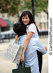 Couple hugging during shopping trip
