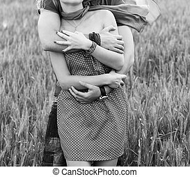 Couple hugging in a green land black and white