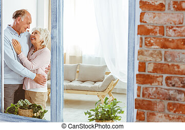 Couple hugging in apartment