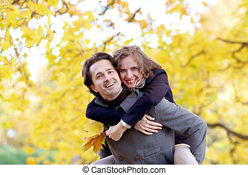 Couple hugging in autumn park