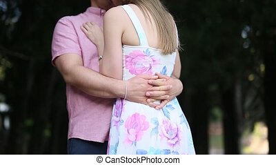 Couple hugging in the forest. Territory of the park Milocer, Mon