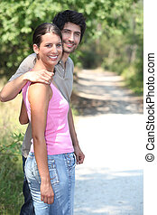 Couple hugging in the park
