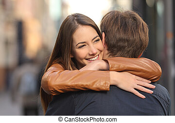 Couple hugging in the street - Portrait of a happy couple...