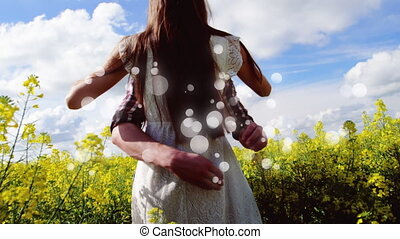 Couple hugging on flower field on sunny day