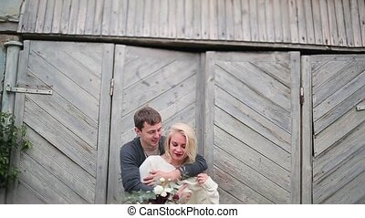 Couple hugging on the background of wooden door