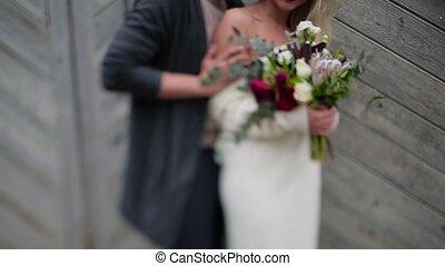 Couple hugging on the background of wooden door