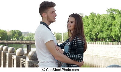couple hugging on the waterfront in the sity