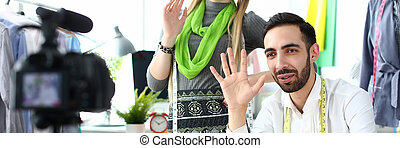 Couple husband and wife portrait wave hand and looks at ...