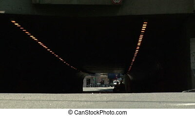 Couple in a dark tunnel - Young couple walking in a dark...