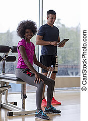 couple in a gym have break