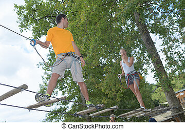 couple in a rope adventure park