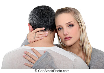 Couple in a serious embrace
