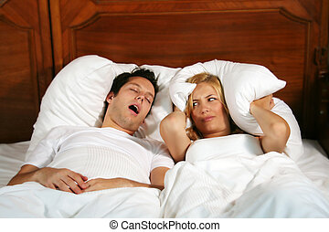 couple in bed - Couple in bed while the woman is trying to...