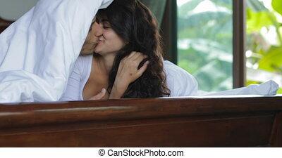 Couple In Bed Kissing Under Blanket, Lovers Bedroom Happy...